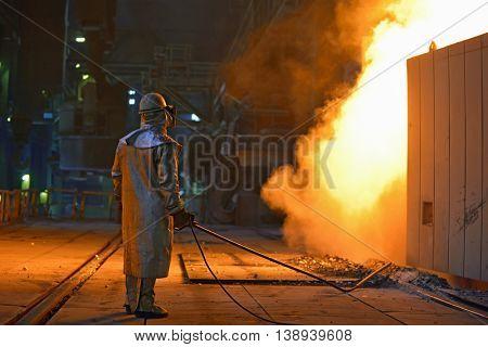 Industrial steel worker inside of steel plant