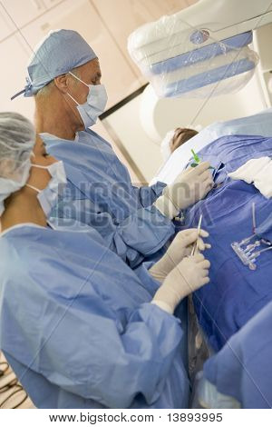 Surgeons Operating On Patient poster
