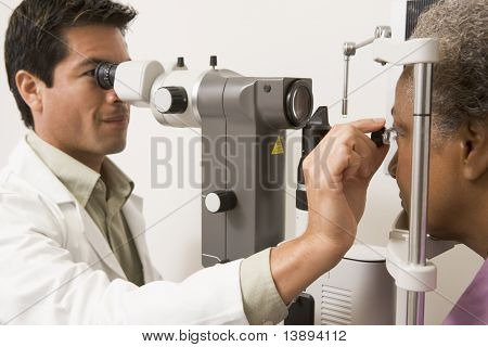 Doctor Checking Patient's Eyes