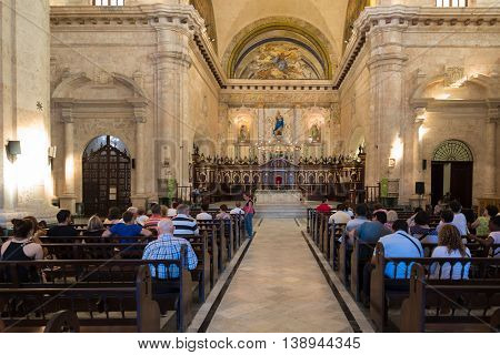 HAVANA,CUBA - JULY 17,2016 :  Church goers  attending mass at the Cathedral of Havana in Cuba