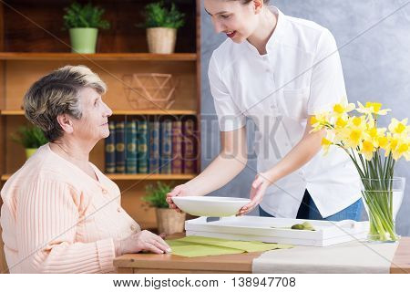 Home Nurse Serving Soup