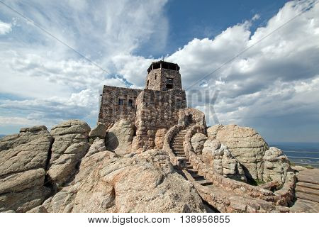 Harney Peak Fire Lookout Tower under cirrus clouds in Custer State Park in the Black Hills of South Dakota USA