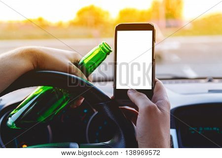 Drunk young man driving a car with a bottle of beer and mobile phone. Don't drink and drive concept. Don't text and drive. Driving under the influence, Driving while intoxicated. poster