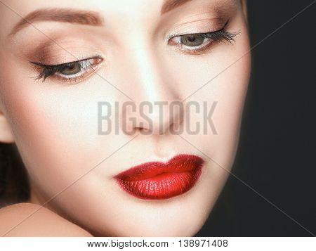 Close up portrait of beautiful young woman face.