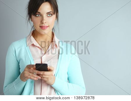 Woman using and reading a smart phone .
