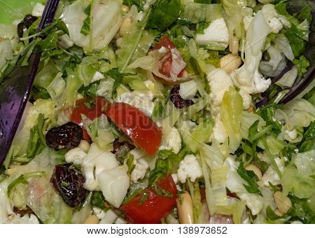 Green salad with oil droplets and different stuff
