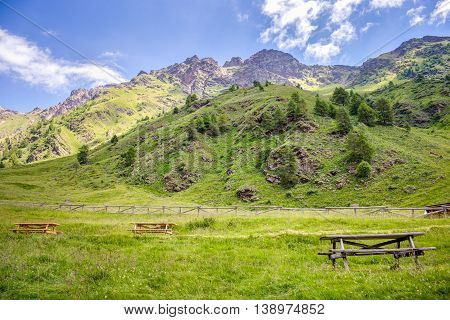 Pic nic table on meadow with mountain view