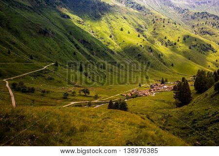 Clouds Cover Village On A Mountaing View (ponte Di Legno, Case Di Viso - Italy)