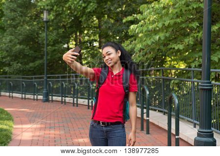 Young african american college student taking a selfie