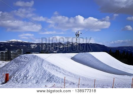 Freestyle Skier Jumping High While Doing 360