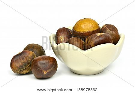 Sweet chestnut in bowl and on a white background