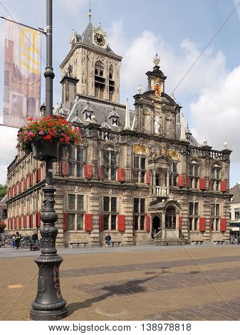Delft Netherlands - July 6 2016: The medieval town hall in the city of Delft at the main city square.
