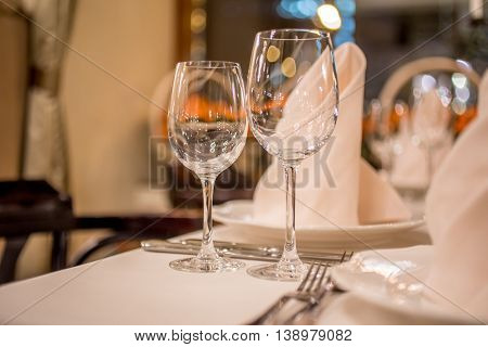 Table setting in restaurant cafe wine glasses