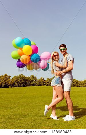 Portrait Of Young Happy Lovely Family With Balloons Having Honeymoon