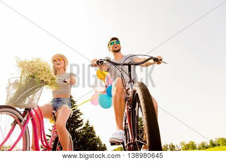 Young Happy Man And Woman Having A Bike Ride