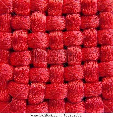 Red chinese woven fabric amulet texture background