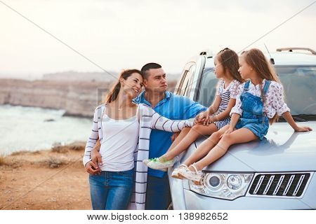 Family trip by car on the sea shore in sunset, travel photo series
