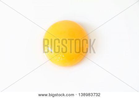 Single egg yolk on white isolated background