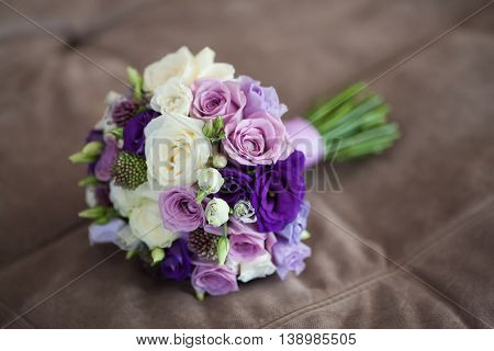 Close up of beautiful wedding bouquet beige background