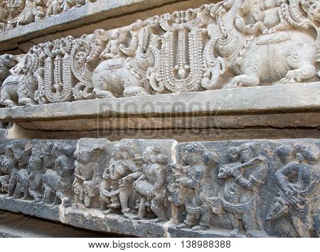 Musicians And Mythical Animals Carved On The Walls Of Hoysaleshwara Temple At Halebidu