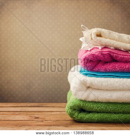 Retro background with fresh towels on wooden table