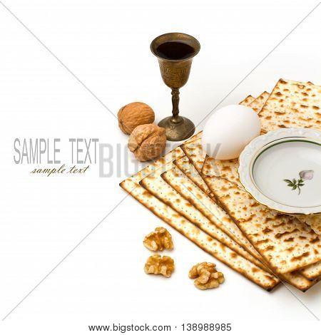 Matzo egg walnuts and wine for passover celebration on white background