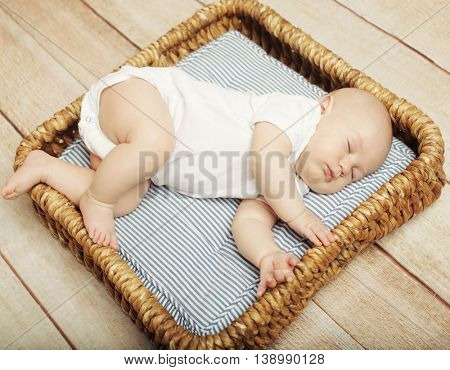 Peaceful baby lying on a bed while sleeping