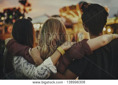 Friends Huddle Happiness Amusement Park Festival Concept