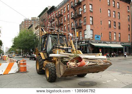 NEW YORK - JUNE 16, 2016: Constriction workers repair street in Lower Manhattan