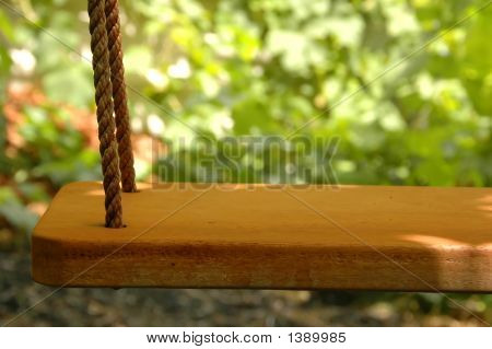 Lonely Swing With A Child'S Hat
