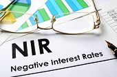 Paper with words NIR  as Negative Interest Rate poster