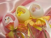 Chicks inside plastic and colorful eggs as surprises for easter holidays poster