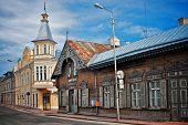 Old wooden houses in small street corner. Rakvere, Estonia. poster