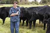 Portrait Of Vet In Field With Cattle poster