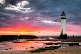 Perch Rock lighthouse at New Brighton, near Liverpool in the UK. At sunset.