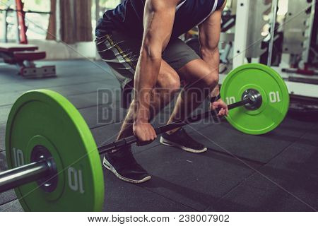 Cropped Image Of Sportsman Practicing Deadlift With Heavy Weight