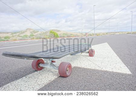 Hdr Picture Vintage Style Longboard Black Skateboard On An Empty Asphalt Desert Road