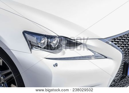 Headlight Of A Modern White Sport Car. The Front Lights Of The Car. Modern Car Exterior Details. Car