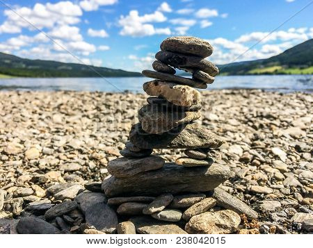 Small Stones Stacked As A Stone Tower Which Can Symbolize Balance, Patience And Mastery.