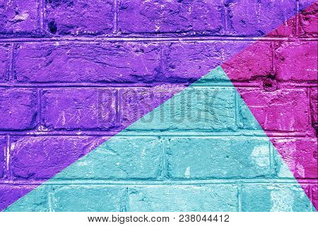 Textured Brick Wall With Bright Abstract Pattern Of Colored Triangles Of Green, Violet And Pink, Abs