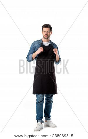Young Bearded Waiter In Apron Looking Away Isolated On White
