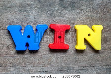 Color Alphabet In Word Win On Wood Background