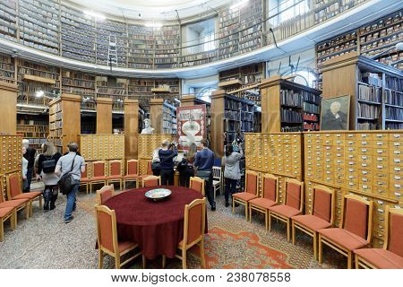 ST. PETERSBURG, RUSSIA - APRIL 20, 2018: People in the Oval hall of Russian depository of the National Library of Russia during Library Night. Annual reading fest Library Night is held in 7th time