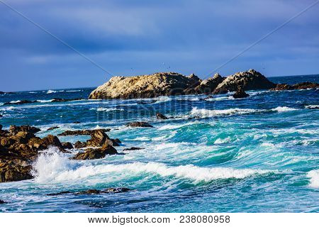 Pebble Beach, California, February 18, 2018:  Wave Action On The Rocks At Pebble Beach Highlighting