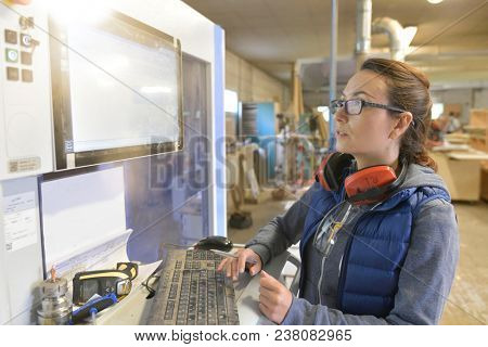 Woodwork factory technician scanning products