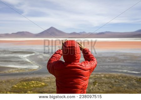 Young Man Taking Photo At Laguna Colorada At Eduardo Avaroa Andean Fauna National Reserve In Bolivia