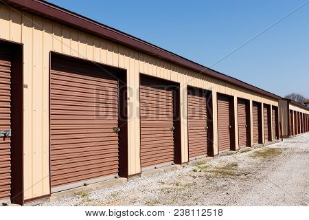 Brown Numbered Self Storage And Mini Storage Garage Units