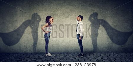 Side View Of A Man And Woman Imagining To Be A Super Hero Looking Aspired.