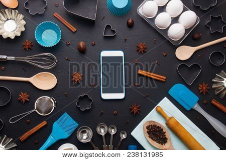 Baking Background With Eggs And Kitchen Tools: Rolling Pin, Wooden Spoons, Whisk, Sieve,  Bakeware,