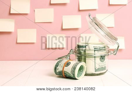 Dollars Savings  - Money Save Concept In Glass Jar
